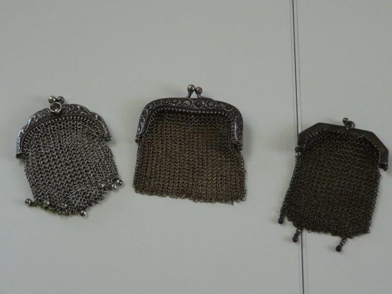 Antieke geweven zilverkleurig geldbeugels