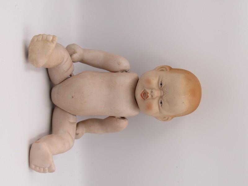 Antieke pop in porselein met twee gezichten
